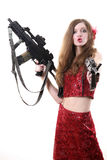 Beautiful girl with weapon. The beautiful girl in a red dress with the weapon Royalty Free Stock Photo
