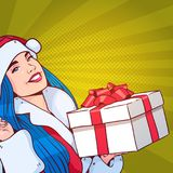 Beautiful Girl Wear Santa Costume Hold Gift Box, Merry Christmas And Happy New Year Concept Retro Pop Art Style. Vector Illustration Stock Image
