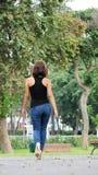 Beautiful Girl Wearing Blue Jeans Walking Royalty Free Stock Photos