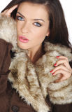 Beautiful girl wearing brown fur. Royalty Free Stock Photo