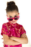 Beautiful girl wearing a chinese dress looking over sunglasses Stock Photos