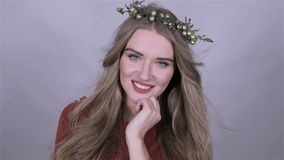 Beautiful girl wearing christmas wreath over white background. stock video footage