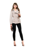 Beautiful girl wearing a coat and black leggings Royalty Free Stock Photography