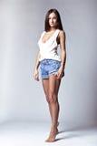 Beautiful girl wearing denim shorts and shirt Royalty Free Stock Images
