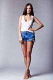 Beautiful girl wearing denim shorts and shirt Royalty Free Stock Image