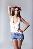 Beautiful girl wearing denim shorts and shirt Stock Photo