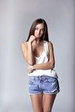 Beautiful girl wearing denim shorts and shirt Royalty Free Stock Photos