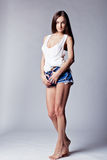 Beautiful girl wearing denim shorts and shirt Royalty Free Stock Photo