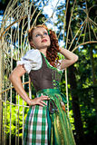 Beautiful girl wearing dirndl in the garden Stock Photos