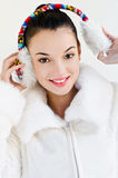 Beautiful girl wearing ear muffs Royalty Free Stock Photo