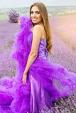 Beautiful girl is wearing fashion dress at field Royalty Free Stock Images