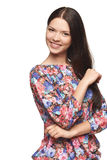Beautiful girl wearing floral shirt standing playfully Stock Images