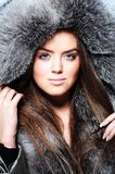 Beautiful girl wearing fur coat Royalty Free Stock Photos