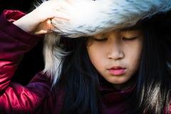 Beautiful girl wearing a fur hooded winter coat Royalty Free Stock Image