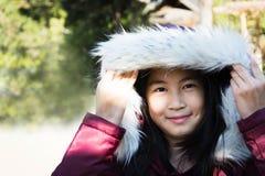 Beautiful girl wearing a fur hooded winter coat Stock Photos