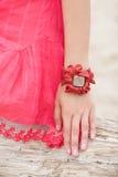Beautiful girl wearing a handmade bracelet. On the sea Stock Photography