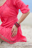 Beautiful girl wearing a handmade bracelet Royalty Free Stock Image