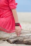 Beautiful girl wearing a handmade bracelet. On the sea Royalty Free Stock Photos