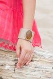 Beautiful girl wearing a handmade bracelet. On the sea Royalty Free Stock Image