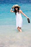 Beautiful girl wearing hat on beach Stock Photos