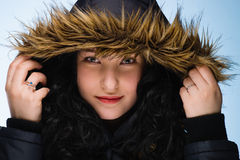 Girl with hood Stock Images