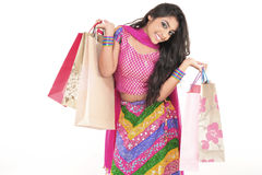 Beautiful girl wearing indian ethnic dress. Attractive Indian Girl With Hands Full of Shopping Bags Stock Photo