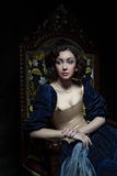 Beautiful girl wearing a medieval dress. Studio works inspired by Caravaggio. Cris. XVII Stock Photo