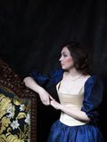 Beautiful girl wearing a medieval dress. XVII. Beautiful girl wearing a medieval dress. Cris. XVII stock photo