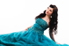 Prom dress. Beautiful girl wearing a prom dress, she is sitting on the ground, horizon format royalty free stock photography