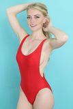 Beautiful girl wearing a red monokini Royalty Free Stock Photography