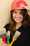 Beautiful girl wearing a red safety helmet. Royalty Free Stock Images
