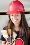Beautiful girl wearing a red safety helmet. Stock Images