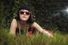 Beautiful girl wearing red sun glasses Stock Photo