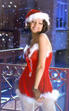 Beautiful girl wearing santa claus clothes Stock Images