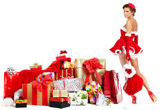 Beautiful  girl wearing santa claus clothes with christmas g Stock Photo