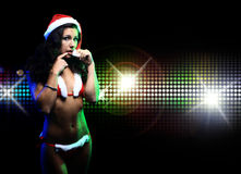 Beautiful girl wearing santa claus clothes on disco background Royalty Free Stock Photos