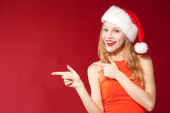 Beautiful girl wearing santa claus clothes Royalty Free Stock Photo