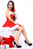 Beautiful girl wearing santa claus clothes Stock Photo