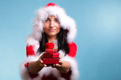 Beautiful girl wearing santa claus gift box Stock Photos