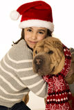 Beautiful girl wearing a santa hat hugging a Shar Pei dog Stock Images