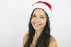Beautiful girl wearing a santa hat Stock Photography
