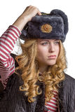 Beautiful  girl wearing a  soldier's cap Royalty Free Stock Photography