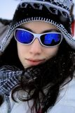 Beautiful girl wearing sunglasses. Girl posing and having fun in snow Stock Photos