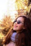 Beautiful girl  wearing a sunglasses  and scarf, enjoying sun in Royalty Free Stock Image