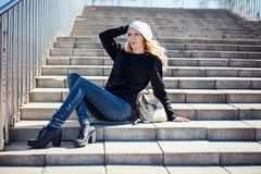 Beautiful girl wearing white hat, black hoody, shoes and jeans Stock Photography