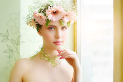 Girl wearing wreath of flowers Stock Image