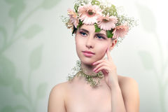 Beautiful girl wearing wreath of flowers Royalty Free Stock Photos