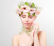 Beautiful girl wearing wreath of flowers Stock Photos