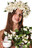 Beautiful girl wearing a wreath of jasmine and a cup of green tea Royalty Free Stock Photos
