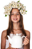 Beautiful girl wearing a wreath of jasmine and a cup of green tea Royalty Free Stock Photo